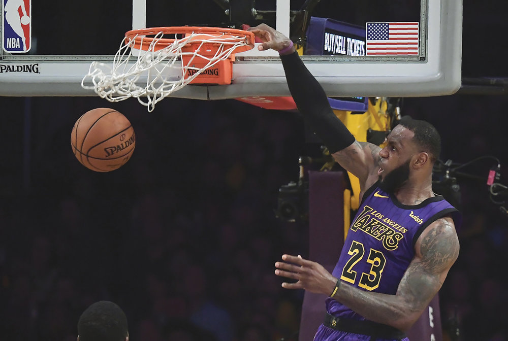 Los Angeles Lakers forward LeBron James dunks during the second half of the team's NBA basketball game against the Utah Jazz on Friday, Nov. 23, 2018, in Los Angeles. The Lakers won 90-83. (AP Photo/Mark J. Terrill)