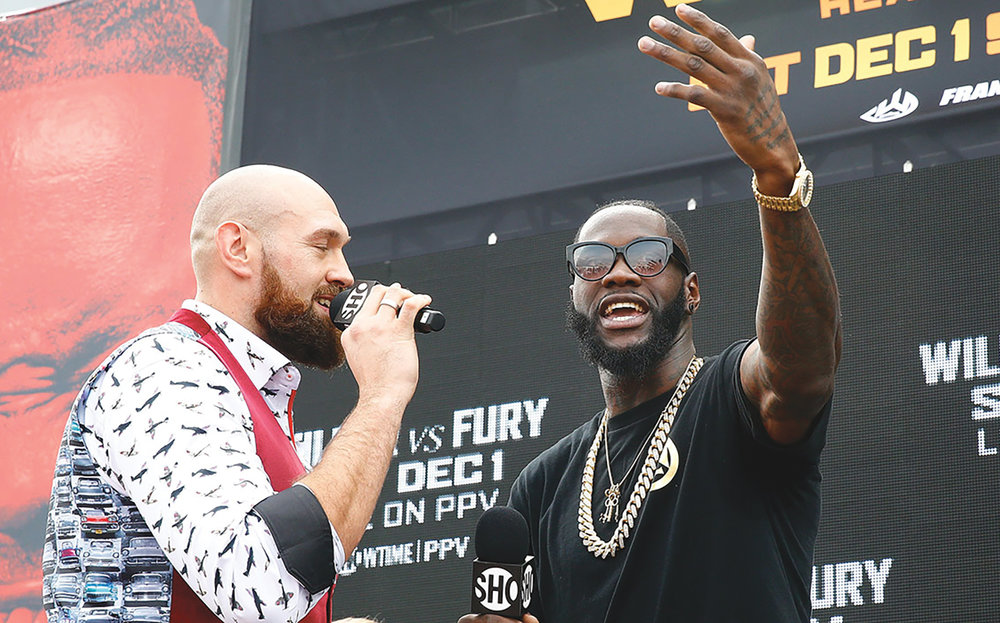 Wilder vs Fury on the US Intrepid in New York, promoting their Heavyweight Championship fight on December 1st at Staples Center. (Mike Stobe/Getty Images courtesy photo)