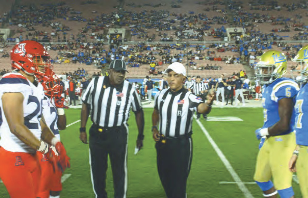 Matt Barnes (L) and John Navarrow at coin toss of PAC-12 Game. Barnes was a member of the C.F.O.A. South Bay Unit and has done College Football Play-off semi-final and Championship games. (Earl Heath Photo)