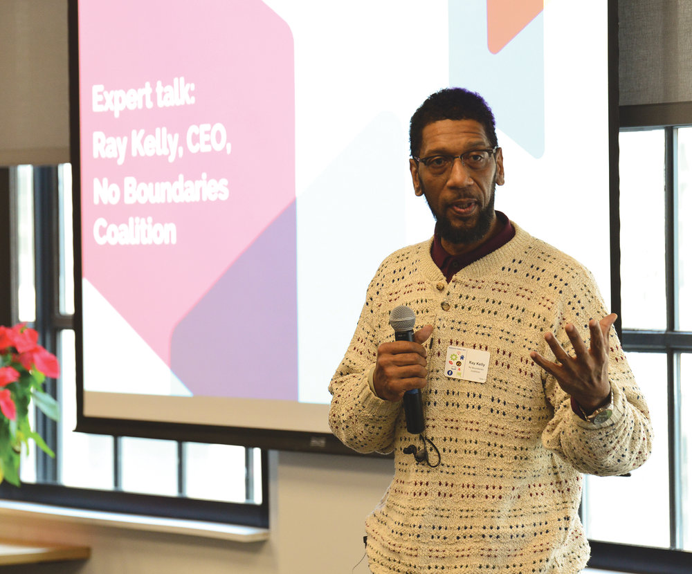 "Ray Kelly, the chief executive of the No Boundaries Coalition, talks about community outreach efforts during a ""design jam"" hosted by Facebook in Baltimore, Md. in 2018. Facebook has partnered with community activists and civic leaders to develop and implement strategies designed to reduce violence in the city. (Freddie Allen/AMG)"