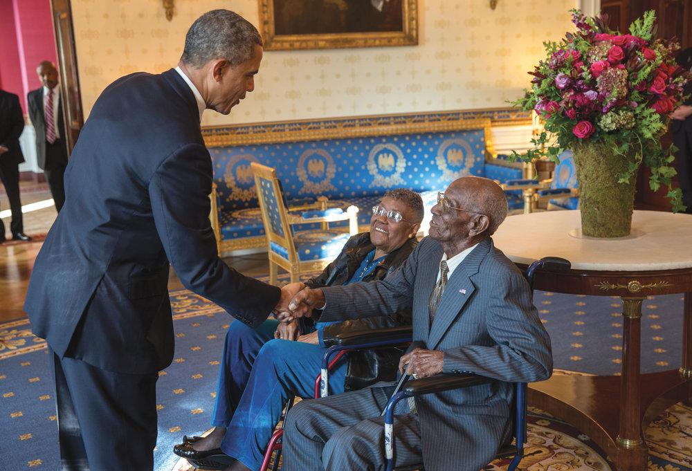 President Barack Obama greets Richard Overton and Earlene Love-Karo.