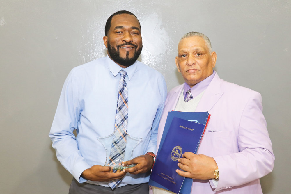 Bakersfield New's Observer James Luckey Jr. (L) excepting Rev. Martin Luther King Jr. Young Businessman Award on behalf of himself, Jon Coley, and the late Founder Joseph Coley. (Carrington Prichett photo)