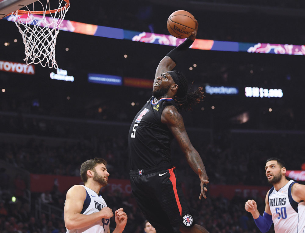 Montrezl Harrell rolls sown the lane and dunks on the Mavericks, for 2 of his career high 32 points. (Courtesy photo)