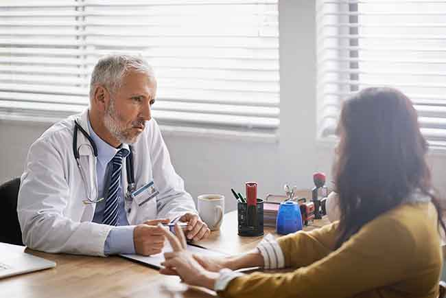 seated-male-doctor-advising-woman-article.__v60019633.jpg