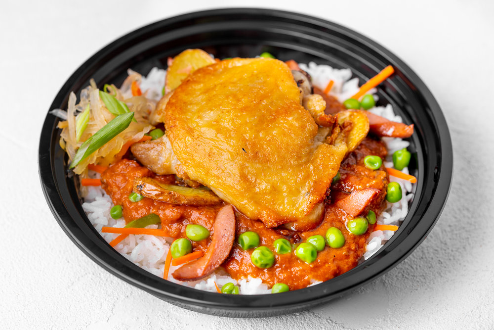 Chicken Afritada - Pan-seared chicken thigh simmered in tomato sauce, with hot dog, roasted potato and fresh vegetables.
