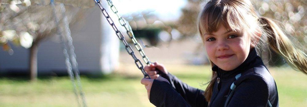 girl+in+park+swing