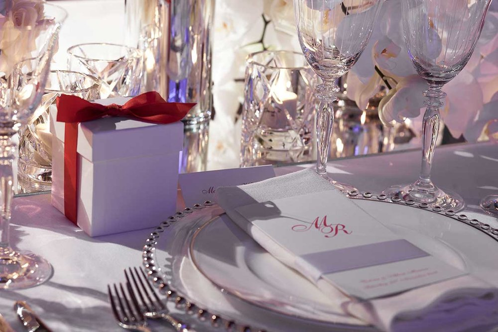 Tablescape Wedding dinner menu on plate setting and white gift box red ribbon