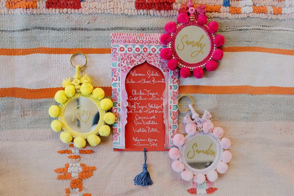 Moroccan style wedding menu and guest name escort cards pompom Morrocan mirror keyrings