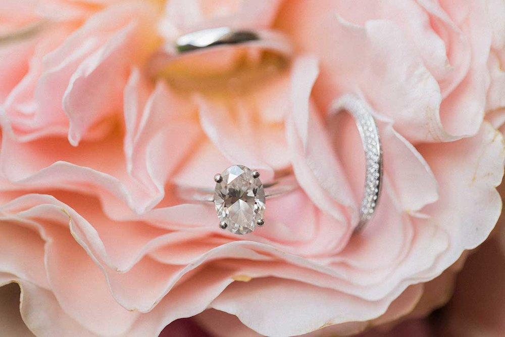 Oval diamond engagement and wedding rings