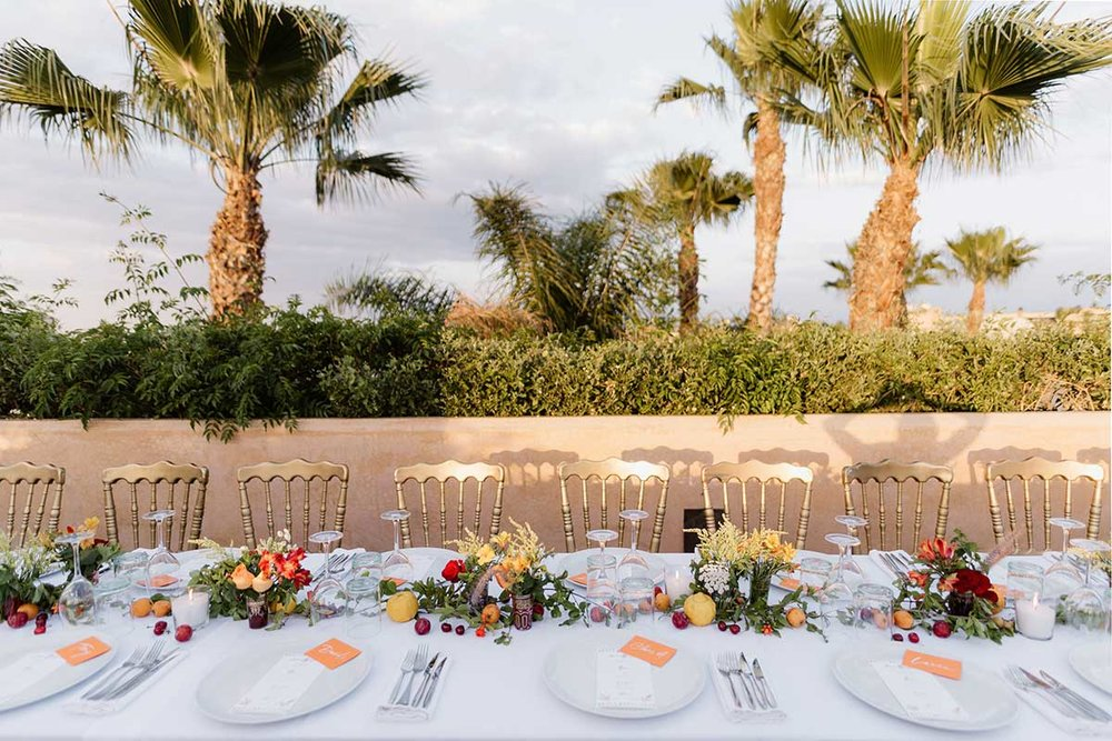 Tablescape rooftop dinner Marrakech palm trees El Fenn