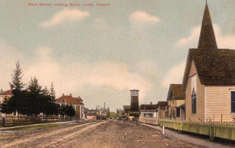 Main Street Looking North in Lents.  Oliver Lent built and operated a sawmill for many years. He served as school director, road supervisor and justice of the peace. Oliver Lent died in 1899. Oliver Lent's town was originally built as a self-sufficient town and suburb of Portland. As Portland grew and absorbed other smaller towns, Lents was annexed into the City in 1912.