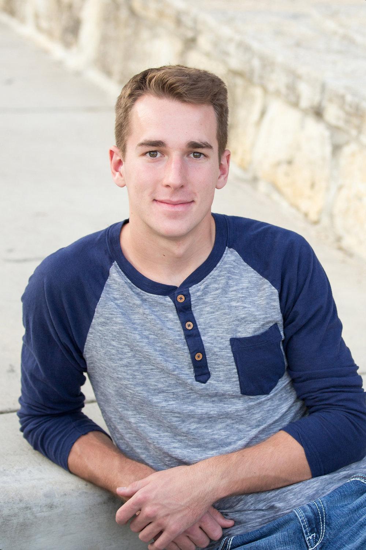Senior-boy-sitting-blue-baseball-tshirt.jpg