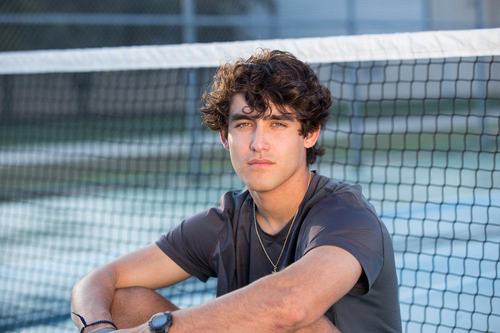Senior-boy-tennis-court.jpg