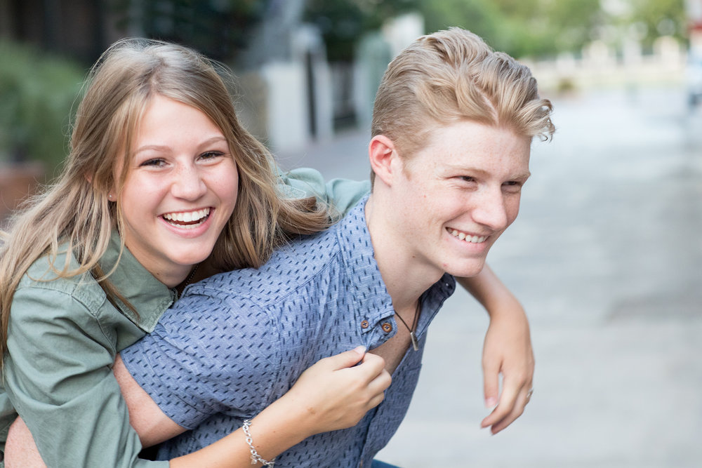 Senior-brother-teen-sister-piggyback-laughing.jpg