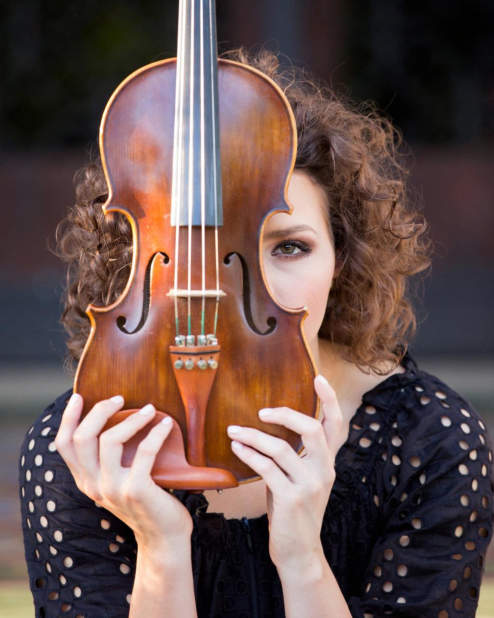 Senior-girl-holding-violin-over-one-eye.jpg