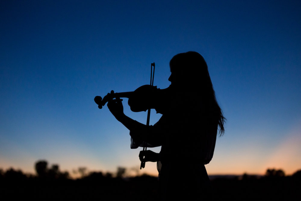 Senior-girl-sunset-playing-violin-silhouette.jpg