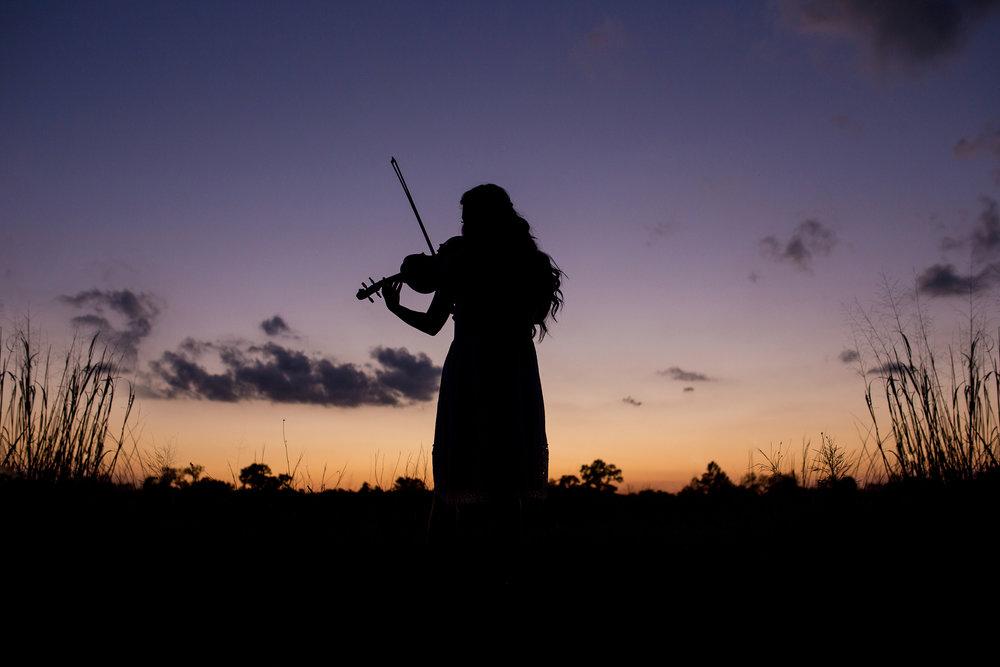 Senior-girl-sunset-silhouette-playing-violin.jpg