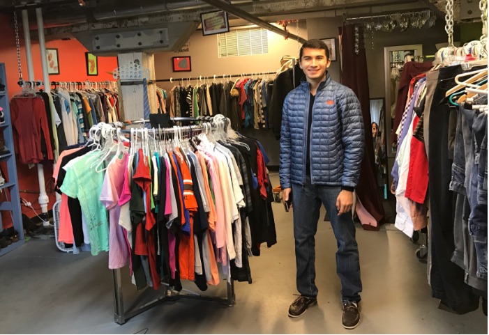 Zachary the founder of threads of care is in front of all the clothes they have collected! Zach was a highschooler when he started threads of care and now has passed it down to a fellow student!