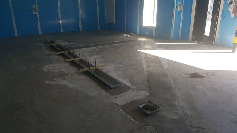 - Stainless steel channel and gully are installed
