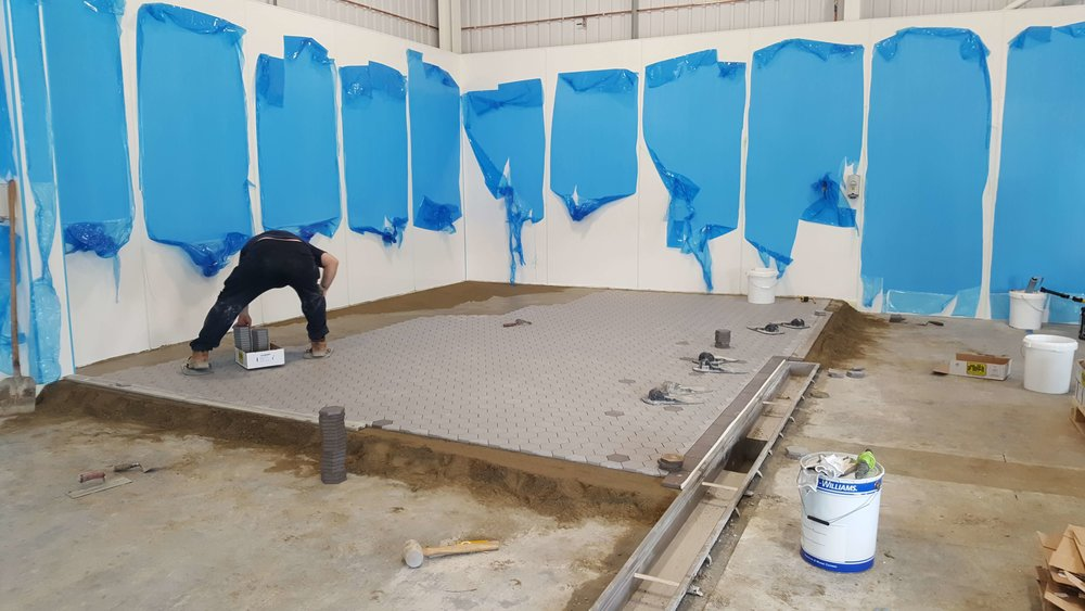 - our new tiled floor slopes towards the central drain
