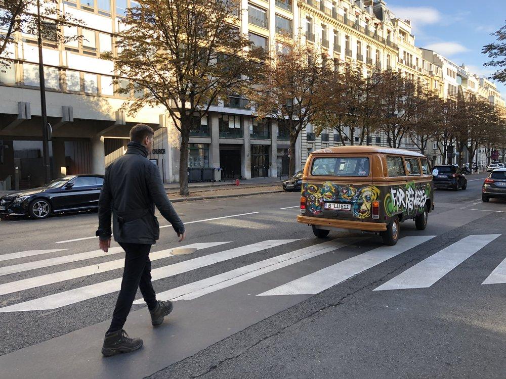 Grig walking behind the vw bus in Paris2.JPG