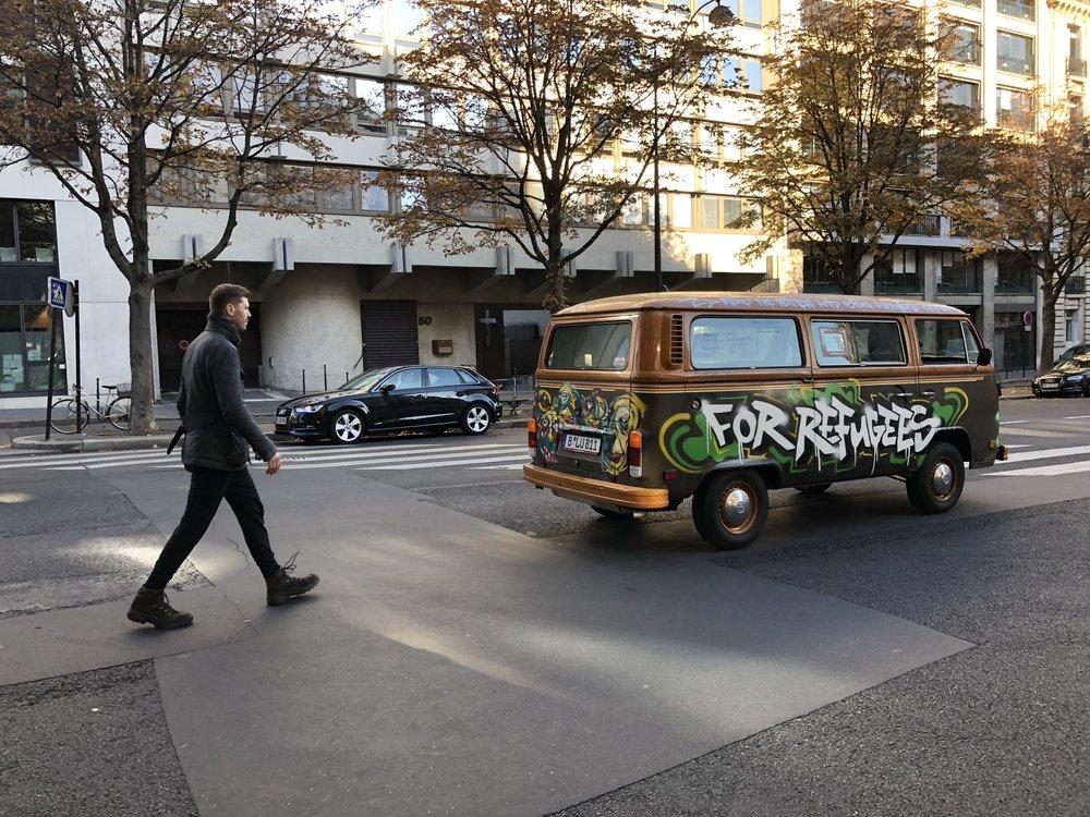 Grig walking behind the vw bus in Paris3.JPG