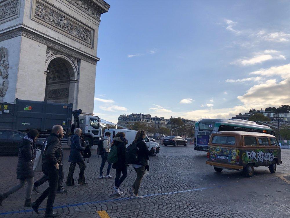 Friends at Arc de Triomphe with vw bus.JPG