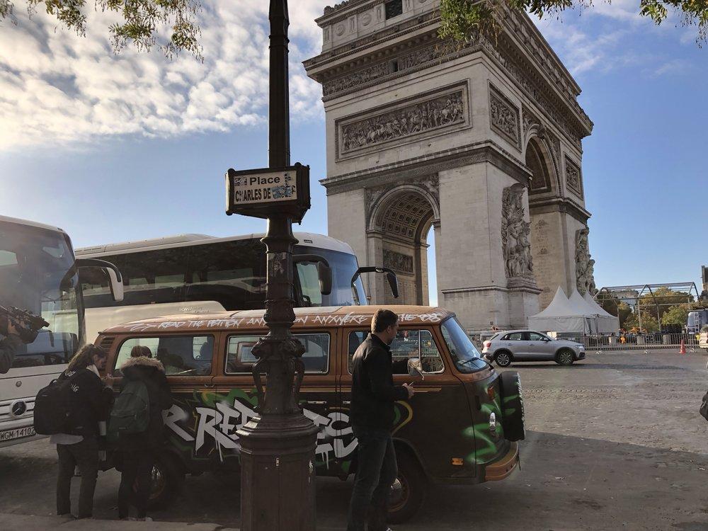 People signing vw bus outside arc de triomphe.JPG