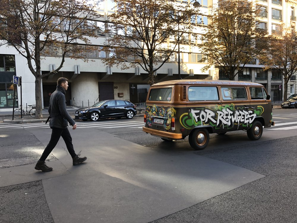 Grig walking behind the vw bus in Paris3.JPG