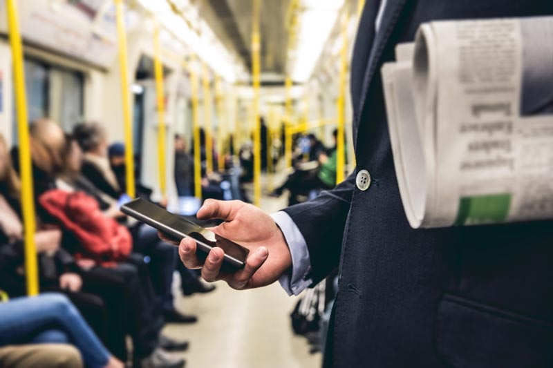 how-bjj-works-man-on-train-reading-blog-on-phone-iStock-648158132.jpg