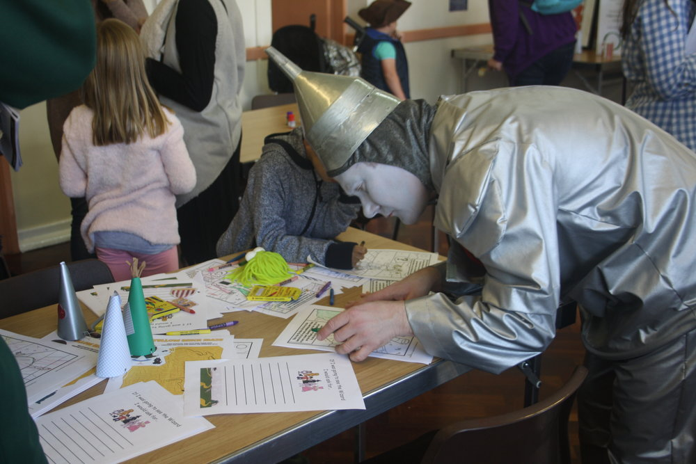 Above:  We even had our very own Tin Man on hand to assist on our Colouring Station!     Right:  Our hashtag allowed us to collect any photos from the day! We even crafted a few props for the little (& big ones!) to play with & keep them entertained. We kept the entertainment in separate sections, & The Toy Library were even kind enough to bring a Sensory Tent with them for children to have some time out if they needed it! (I was tempted to get in there myself!) There were also separate rooms available for use if required.