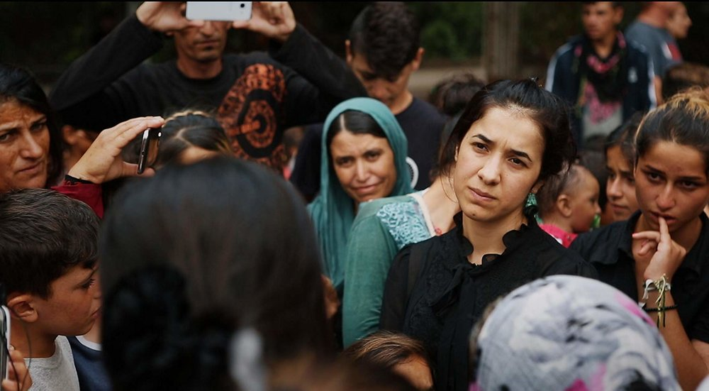 On Her Shoulders - Nadia Murad, a 23-year-old Yazidi, survived genocide and sexual slavery committed by ISIS. Repeating her story to the world, this ordinary girl finds herself thrust onto the international stage as the voice of her people.(Documentary, Bio: 1hr & 35min)Showtimes: Friday 10/26 Palace Film Sponsor - Charlene Trotter, Trotter Consulting