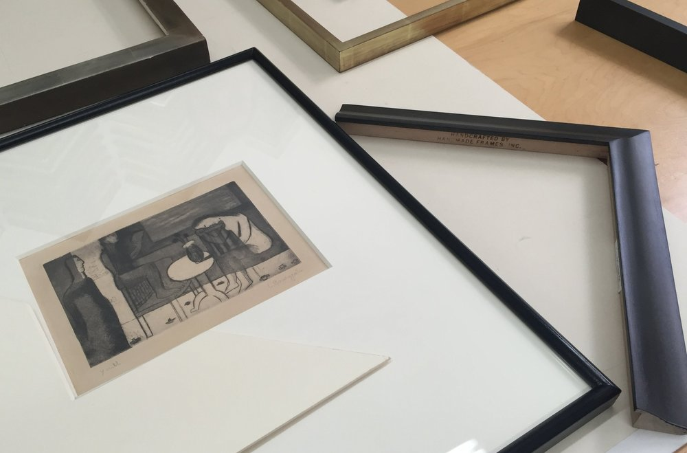 Designing custom archival mats and frames.