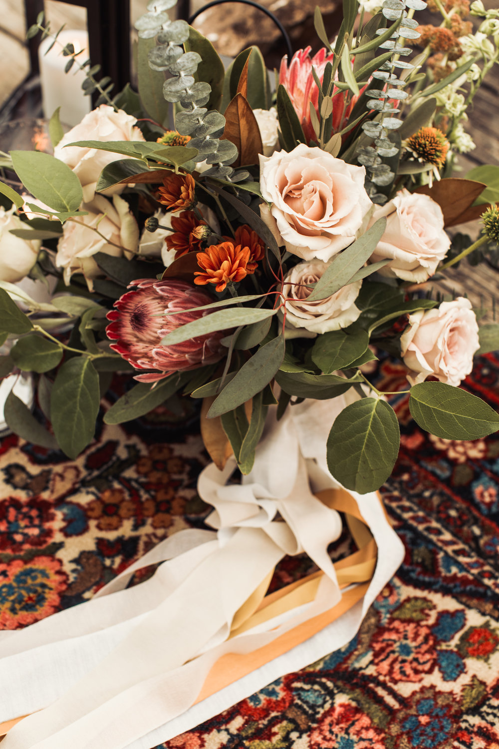 moody greenery bouquet protea bouquet elope