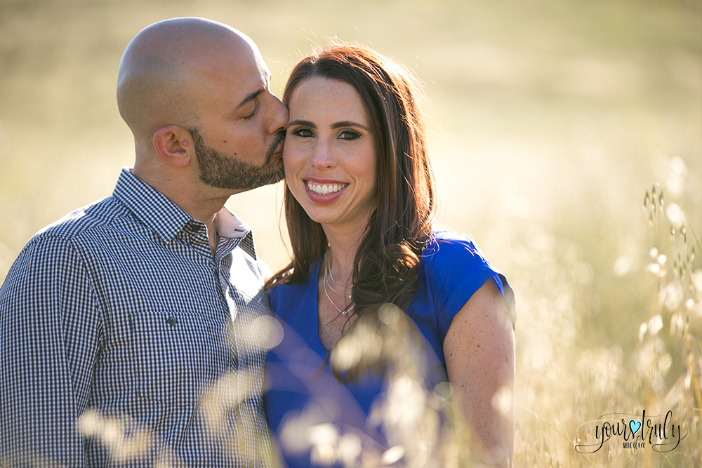 Engagement Photography Services in Orange County, CA - Future husband kissing his future bride on the cheek.