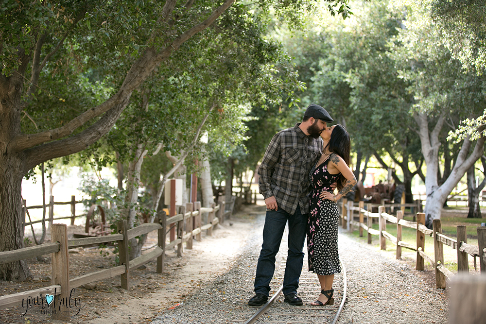 1-year anniversary photography feature - Couple kissing on train tracks.