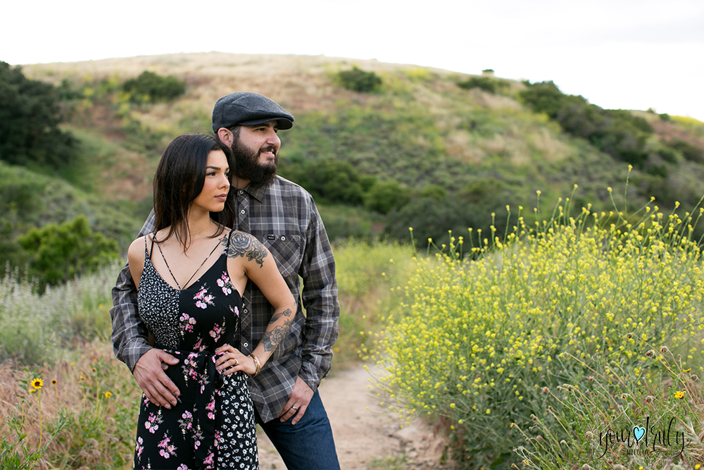 1-year anniversary photography feature - Couple standing together staring off into the distance.