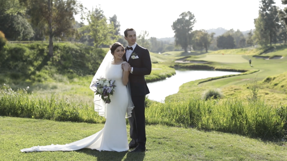 La Habra Heights Wedding Videography - Hacienda Golf Course - Couple standing on the green in a classic pose for the camera.