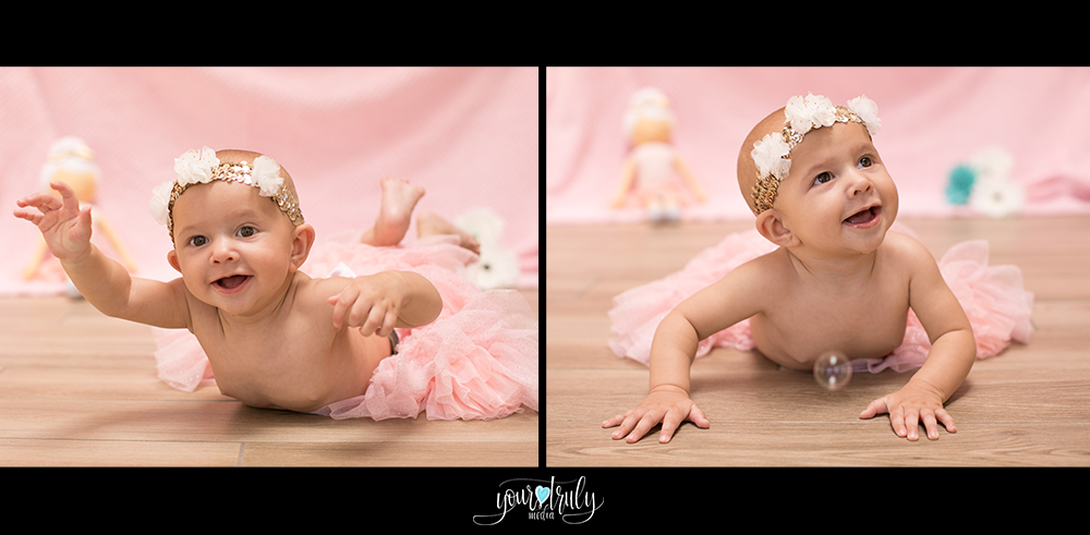 Orange County California Baby Photography Session - Baby girl on her tummy performing a swimming motion.