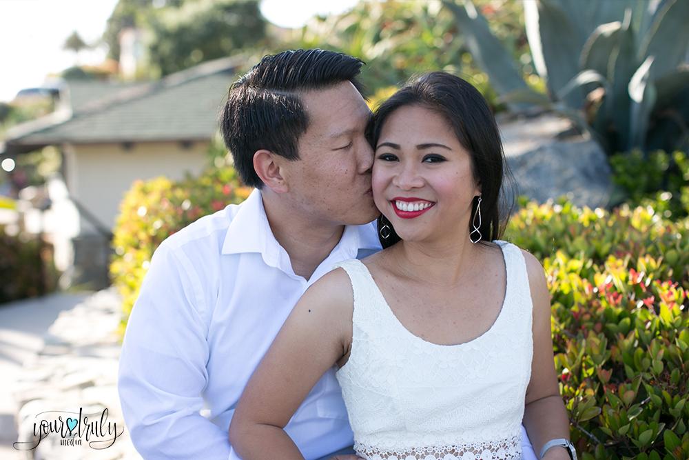 Engagement photography - Laguna Beach, CA - Future groom kissing his future brides cheek.