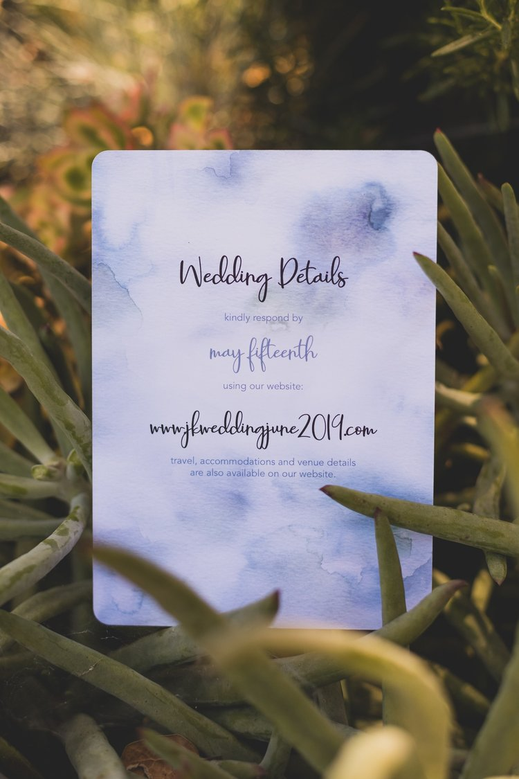 How To Keep Your Bridal Party Informed: A Guide To Keeping Everyone In The Loop - A purple watercolor wedding invitation.