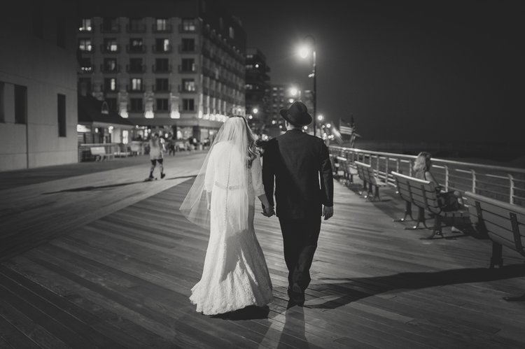 Last Minute Checklist: Things to Know Before Your Outdoor Wedding - A newlywed couple walking down the pier in the evening.
