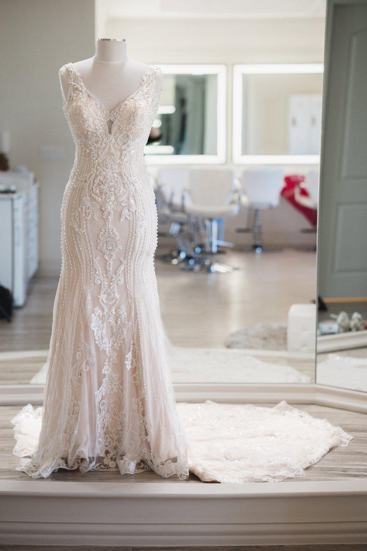 Sleek, modern, off-white wedding dress with embroidery.