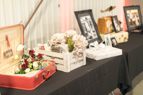 An aviation themed wedding welcome table using vintage suitcases.