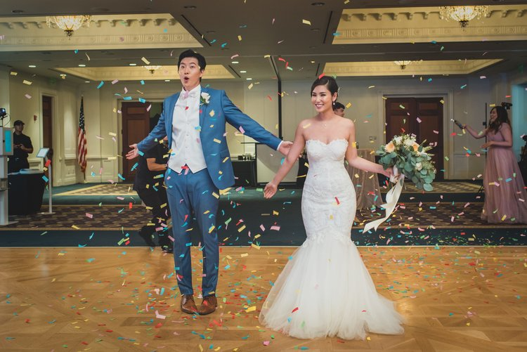 Bride and groom in a shower of confetti