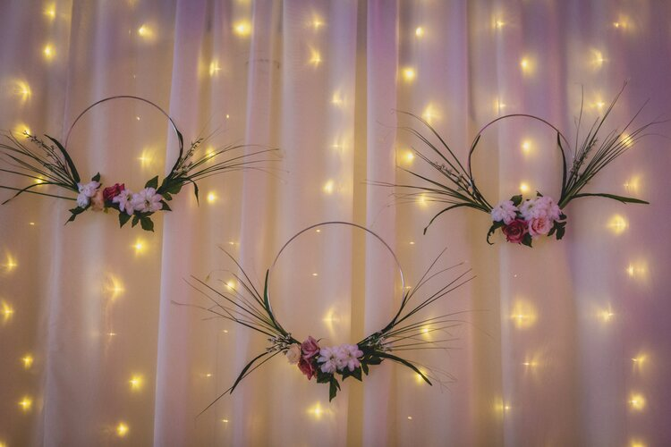 Fairy lights with halos of flowers.