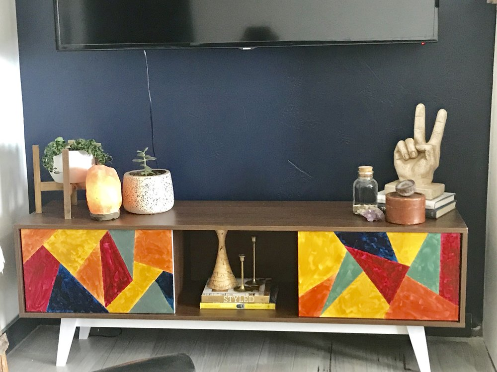 From drab to fab. Update your plain tv console with acrylic paints.