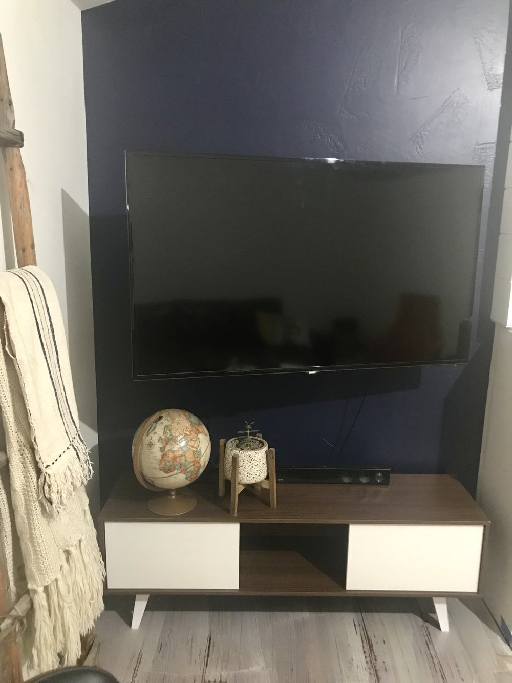 I ordered this tv console from Wayfair. It cost me a whopping $167.99. Not expensive at all. The console I wanted was $799. I used it as my inspiration. Does anyone else do this? I knew the console was going to come in a million pieces. And the quality, well let's just say it's not an heirloom piece. It came together fairly easy easy for my husband. I would have added a photo of him assembling it. But I like to show the world a better side of us. Giving me the bird with one hand and a screw driver in the other. You get the idea. I tell him he shouldn't be so handy. You will get to see more of his handy work in future posts.  I wasn't concerned about the quality. This was a form over function situation. The TV is mounted to the wall, I needed a piece of furniture to ground the Tv so it didn't look like it was floating. I guess it still does. But I needed something to hold the sound bar and hold my cool stuff. Bonus there is a little storage.