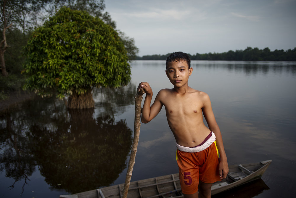 Boy at Siak river, Sumatra / Indonesia