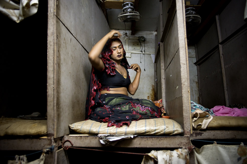 A transgender sex-worker in the cubicle where she/he sells sex from, in Mumbai's red-light districts, Kamathipura / India - 2011